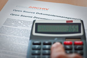Calculator on a document headlined Open Source Document Management